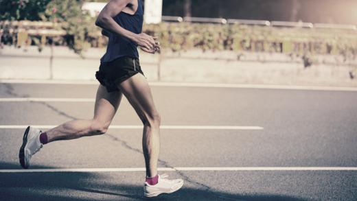 Male runner running on the road